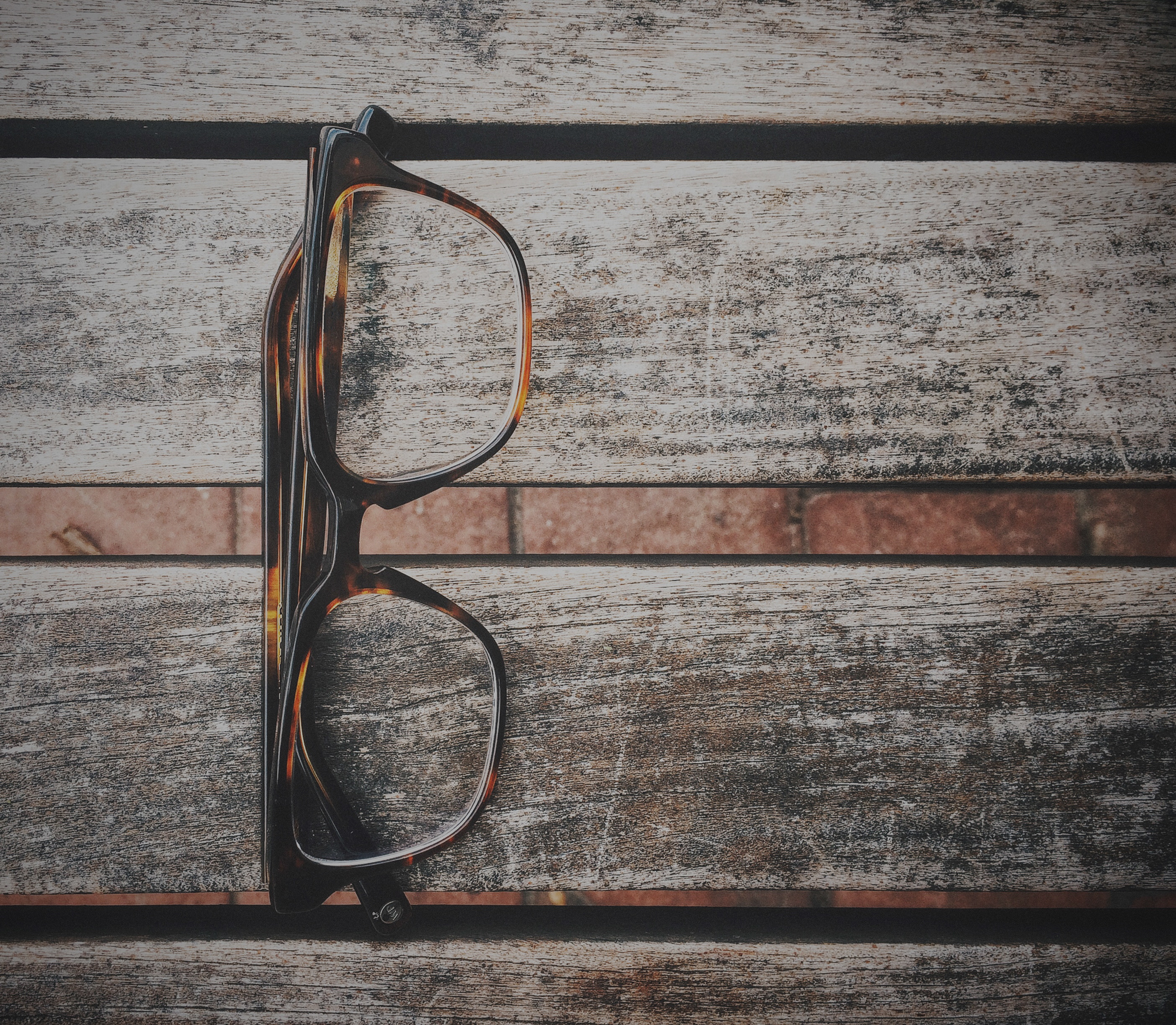 glasses on wood